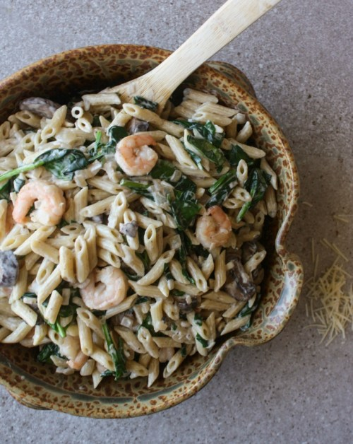 Creamy Shrimp Spinach Pasta with Mushrooms. Easy seafood pasta dish that is creamy and delicious.