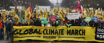 People demonstrate during a protest march ahead of the 2015 Paris Climate Conference, known as the COP21 summit, along Strasse des 17 Juni in Berlin, Germany November 29, 2015. REUTERS/Fabrizio Bensch