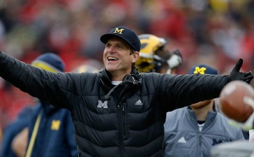 Head coach Jim Harbaugh of the Michigan Wolverines reacts to a roughing the kicker call against his team during the first quarter against the Ohio State Buckeyes at Michigan Stadium on Nov. 28, 2015 in Ann Arbor