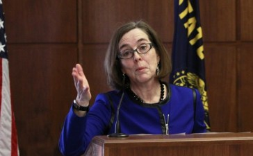 Oregon Governor Kate Brown speaks at the state capital (REUTERS/Steve Dipaola)