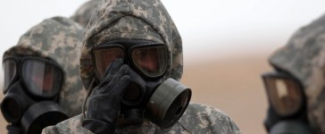 Soldiers wear masks as they take part in a military exercise simulating a chemical weapons attack during the international Eager Lion military event on June 2, 2014 at Prince Hashem Bin Abdullah II training center, in Zarqa, 30 km east of Amman, Jordan. The US and the Kingdom of Jordan are conducting Exercise Eager Lion, which has been conducted annually since 2011, and includes countries from five different continents and more than 12,500 participants. Khalil Mazraawi/AFP/Getty Images.