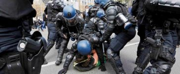 French riot police officers detain a protestor during a demonstration against the French labor law proposal in Lyon, France, as part of a nationwide labor reform protests and strikes, April 28, 2016. REUTERS/Robert Pratta