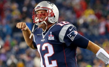 Tom Brady of the New England Patriots cheers as he runs on to the field before the game against the Pittsburgh Steelers at Gillette Stadium on September 10, 2015