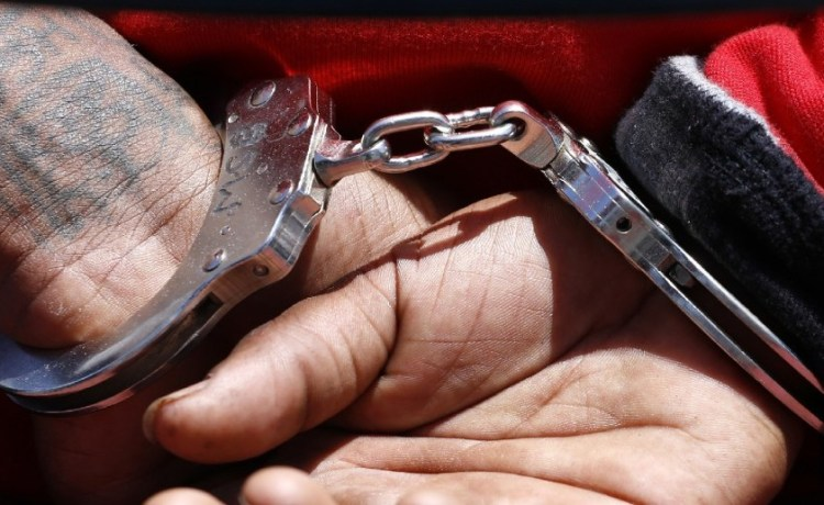 The handcuffs of a suspected member of the Broadway Gangster Crips street gang (REUTERS/Jonathan Alcorn)