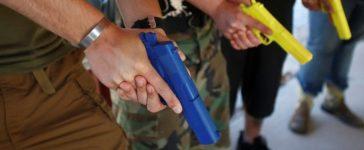 Participants practice weapons handling. REUTERS/Jim Urquhart