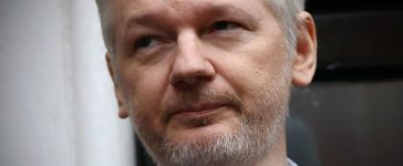 Julian Assange speaks from the balcony of the Ecuadorian Embassy (Getty Images)