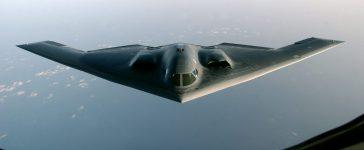 """A B-2 Spirit proceeds to an undisclosed location after flying a mission over Iraq, March 27, 2003. A U.S. B-2 bomber on Friday dropped two earth-shattering 4,600-pound (2,086 kg) """"bunker-buster"""" bombs on a downtown Baghdad communications tower, defense officials said. it was the first use of the big bombs in a week-long pounding of the Iraqi capital. U.S.-led jets and ships have used more than 5,000 bombs and missiles against Baghdad and across Iraq in a war to depose President Saddam Hussein. REUTERS/Cherie A. Thurlby/U.S. Air Force"""