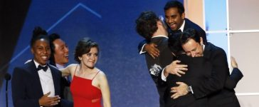 """Aziz Ansari (top R) celebrates with other cast and crew after winning the award for Best Comedy Series for """"Master of None"""" during the 21st Annual Critics' Choice Awards in Santa Monica, California, U.S. on January 17, 2016. REUTERS/Mario Anzuoni/File Photo"""