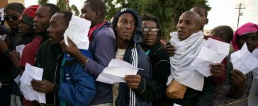 Haitian and African migrants seeking for asylum in the United States, line up outside a Mexican Migration office, on October 3, 2016, in Tijuana, northwestern Mexico. GUILLERMO ARIAS/AFP/Getty Images