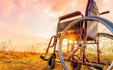 Wheelchair in field. (bubutu/Shutterstock)
