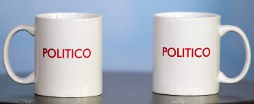 Two Politico coffee mugs rest on a table during the Politico Playbook Breakfast at the Newseum in Washington, DC, November 28, 2012. Jim Watson/AFP/Getty Images.