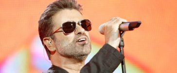 """Singer George Michael performs on stage at """"Live 8 London"""" in Hyde Park on July 2, 2005 in London. (Photo by MJ Kim/Getty Images)"""