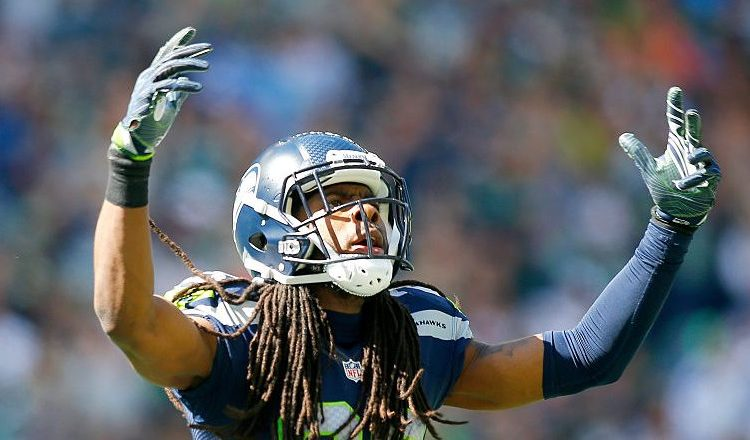 Richard Sherman #25 of the Seattle Seahawks gets the crowd going against the Miami Dolphins in the first half at CenturyLink Field on September 11, 2016 in Seattle. (Photo by Jonathan Ferrey/Getty Images)