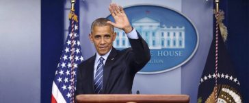 U.S. President Barack Obama waves as he leaves the podium after speaking to journalists during his last news conference of the year at the White House in Washington, U.S., December 16, 2016. REUTERS/Carlos Barria