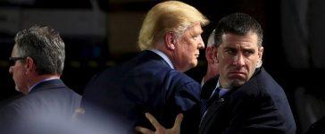 U.S. Secret Service agents surround U.S. Republican presidential candidate Donald Trump during a disturbance as he speaks at Dayton International Airport in Dayton, Ohio, March 12, 2016. REUTERS/Aaron P. Bernstein.