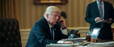 WASHINGTON, DC - JANUARY 28: White House Chief of Staff Reince Priebus (R) looks on as President Donald Trump speaks on the phone with Russian President Vladimir Putin in the Oval Office of the White House, January 28, 2017 in Washington, DC. On Saturday, President Trump is making several phone calls with world leaders from Japan, Germany, Russia, France and Australia. (Photo by Drew Angerer/Getty Images)