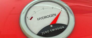 Hydrogen manometer, vintage fuel gauge on red car body (Shutterstock/A.Morando)