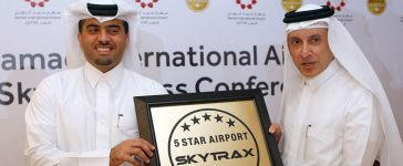 """Hamad International Airport's chief operating officer, Badr al-Meer (L), and Qatar Airways chief executive, Akbar al-Baker, pose for a picture during a ceremony which crowned Doha's Hamad International as a """"five-star"""" airport, one of only six in the world, on January 5, 2017. (Photo credit: STRINGER/AFP/Getty Images)"""