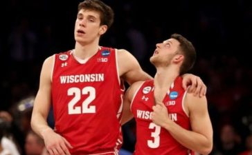 NEW YORK, NY - MARCH 24: Ethan Happ #22 and Zak Showalter #3 of the Wisconsin Badgers walk off the court after being defeated by the Florida Gators in overtime with a score of 84 to 83 during the 2017 NCAA Men's Basketball Tournament East Regional at Madison Square Garden on March 24, 2017 in New York City. (Photo by Elsa/Getty Images)