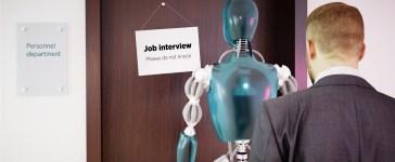A man waiting in line with a robot for a job interview. [Shutterstock - petrmalinak]