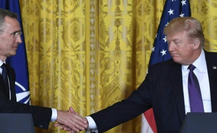 US President Donald Trump (R) and NATO Secretary General Jens Stoltenberg shake hands during a joint press conference in the East Room at the White House in Washington, DC, on April 12, 2017. / AFP PHOTO / Nicholas Kamm (Photo credit: NICHOLAS KAMM/AFP/Getty Images)