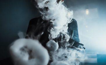 Man creates a vape cloud. Losev Artyom/Shutterstock.