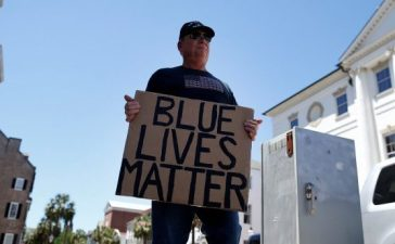 A lone Blue Lives Matter supporter holds a sign outside the Federal Courthouse before the Federal court hearing of former North Charleston police officer Michael Slager in Charleston