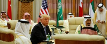 U.S. President Donald Trump sits down to a meeting with of Gulf Cooperation Council leaders, including Saudi Arabia's King Salman bin Abdulaziz Al Saud (R), during their summit in Riyadh, Saudi Arabia May 21, 2017. REUTERS/Jonathan Ernst