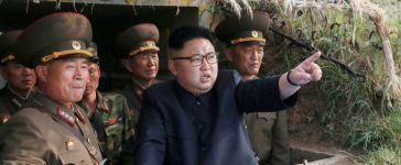 North Korean leader Kim Jong Un inspects the defence detachment on Jangjae Islet and the Hero Defence Detachment on Mu Islet located in the southernmost part of the waters off the southwest front, in this undated photo released by North Korea's Korean Central News Agency (KCNA) on May 5, 2017. KCNA/Handout via REUTERS/File Photo