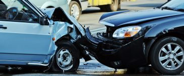 Two cars in the aftermath of a wreck. (PHOTO: Anna Baburkina/Shutterstock)