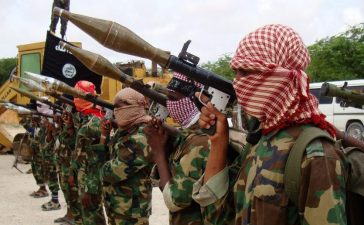 Militants belonging to Somalia?s Al-Qaeda-inspired Shebab Islamists stand in formation on October, 21, 2010 during a show of force in Somalia's capital Mogadishu. A Briton held hostage for close to a week in Somalia flew out of the country and was headed for Kenya on Octobner 21, a day after being released by his captors, AFP PHOTO/STRINGER (Photo credit should read STRINGER/AFP/Getty Images)