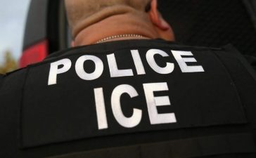 U.S. Immigration and Customs Enforcement (ICE), agents detain an immigrant on October 14, 2015 in Los Angeles, California. ICE agents said the immigrant, a legal resident with a Green Card, was a convicted criminal and member of the Alabama Street Gang in the Canoga Park area. ICE builds deportation cases against thousands of immigrants living in the United States. Green Card holders are also vulnerable to deportation if convicted of certain crimes. The number of ICE detentions and deportations from California has dropped since the state passed the Trust Act in October 2013, which set limits on California state law enforcement cooperation with federal immigration authorities. John Moore/Getty Images.
