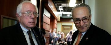 U.S. Senate Minority Leader Chuck Schumer (D-NY) (R) and Sen. Bernie Sanders (I-VT) arrive at a news conference on release of the president's FY2018 budget proposal on Capitol Hill in Washington, U.S., May 23, 2017. REUTERS/Yuri Gripas
