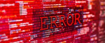 Hackers issue cyber attack causing error in program code. [Shutterstock - iunewind]