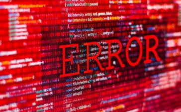 Hackers issue cyber attack causing error in program code. [Shutterstock - iunewind]