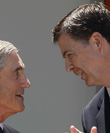 US FBI director nominee Jim Comey (R) applauds outgoing FBI director Robert Mueller in the Rose Garden at the White House in Washington on June 21, 2013. Comey, a deputy attorney general under George W. Bush, would replace Robert Mueller, who is stepping down from the agency he has led since the week before the September 11, 2001 attacks. NICHOLAS KAMM/AFP/Getty Images