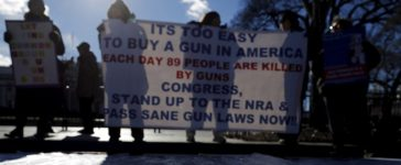 Gun control activists rally in front of the White House in Washington, January 4, 2016. President Barack Obama is expected to announce new gun control curbs this week, but he will have to decide whether to take bold action that would likely spark a major legal challenge from opponents or a more cautious route that may be less effective, legal experts said. REUTERS/Carlos Barria - RTX21067