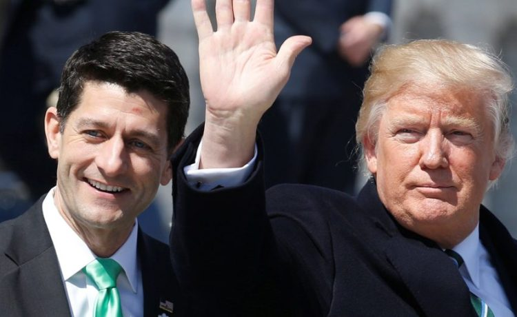 U.S. President Donald Trump waves with Speaker of the House Paul Ryan (R-WI) after attending a Friends of Ireland reception on Capitol Hill in Washington, U.S., March 16, 2017. REUTERS/Joshua Roberts