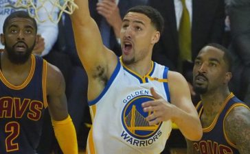 Golden State Warriors guard Klay Thompson (11) shoots against Cleveland Cavaliers guard Kyrie Irving (2) in the first quarter of the NBA Finals for the 2017 NBA Playoffs at Oracle Arena. Mandatory Credit: Kelley L Cox-USA TODAY Sports - RTX38MF5
