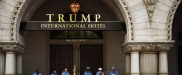 Police officers wait for the marchers in the entrance of the Trump International Hotel which they are assigned to protect during the People's Climate Movement to protest President Donald Trump's enviromental policies April 29, 2017 in Washington, DC. Demonstrators across the country are gathering to demand a clean energy economy. (PHOTO: Astrid Riecken/Getty Images)
