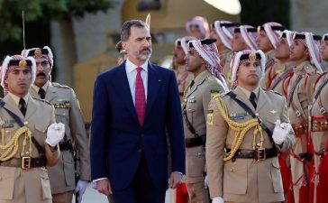 Jordan's King Abdullah and Spain's King Felipe review Bedouin honour guards at the Royal Palace in Amman