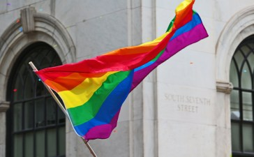 Shutterstock/ PHILADELPHIA - JUNE 8: People waiving gay flag at the 26th Annual Pride Parade on the streets of Center City Philadelphia. Hundreds march to support same sex marriage