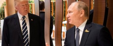U.S. President Trump, Russia's President Putin and President of the European Commission Juncker talk during the G20 Summit in Hamburg