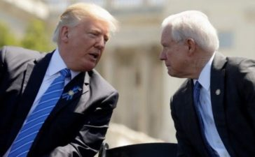 FILE PHOTO - U.S. President Donald Trump speaks with Attorney General Jeff Sessions as they attend the National Peace Officers Memorial Service on the West Lawn of the U.S. Capitol in Washington, U.S. on May 15, 2017. REUTERS/Kevin Lamarque/File Photo