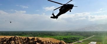 Three UH-60 Blackhawks land at an out post in Northerm Afghanistan, July 22nd, in the Samangan Province. (U. S. Air Force Photo By SSgt Bradley Lail) (released)