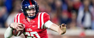 Shea Patterson #20 of the Mississippi Rebels runs the ball during a game against the Mississippi State Bulldogs at Vaught-Hemingway Stadium on November 26, 2016 in Oxford, Mississippi. (Photo by Wesley Hitt/Getty Images)