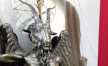 A one-ton, 7-foot (2.13-m) bronze statue of Baphomet -- a goat-headed winged deity that has been associated with satanism and the occult -- is displayed by the Satanic Temple during its opening in Salem, Massachusetts, U.S. September 22, 2016. (Photo: REUTERS/Ted Siefer)