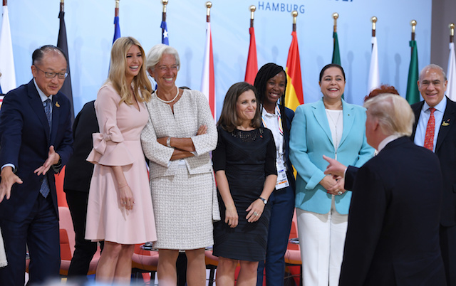 """US President Donald Trump (2nd R) jokes as his daughter Ivanka Trump (2nd L) poses with participants of the panel discussion """"Launch Event Women's Entrepreneur Finance Initiative"""" on the second day of the G20 Summit in Hamburg, Germany, July 8, 2017. REUTERS/Patrik STOLLARZ/Pool - RTX3AM7N"""