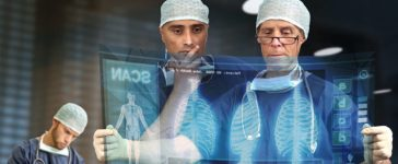 Doctors looking at a virtual medical screen. [Shutterstock - Luis Louro]