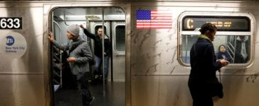 FILE PHOTO: Passengers wait inside a stopped C subway train in New York City after a power failure stopped multiple subway lines during the morning commute in New York, U.S., April 21, 2017. REUTERS/Brendan Mcdermid/File Photo